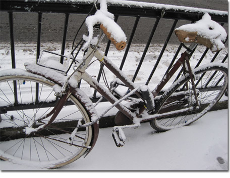 Snow covered bike in Hackney, London Fields